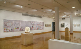 A 25-foot-long photomontage of the Olivetti mural in the Cooper Union show, with a tabletop sculpture in the center foreground.