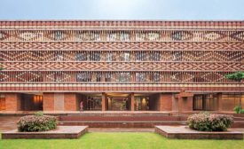 The Krushi Bhawan building's open brick facade uses a pattern inspired by a vernacular textile-dying technique.