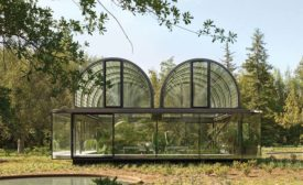 Two glass-brick vaults form the roof of the Pirque Greenhouse.