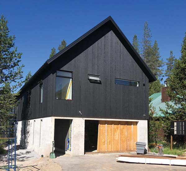 A house nearing completion at the edge of California's Tahoe National Forest.