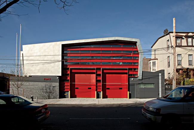 Ennead used immediately identifiable firehouse doors set into alternating glass and metal panels and wrapped in a form inspired by a firefighter's helmet for this Bronx station housing a specialized r
