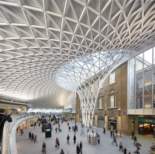 John McAslan + Partners master planned the King's Cross Station redevelopment, which includes reuse, renovation, and new construction. The centerpiece is the Western Concourse, which opened in March a