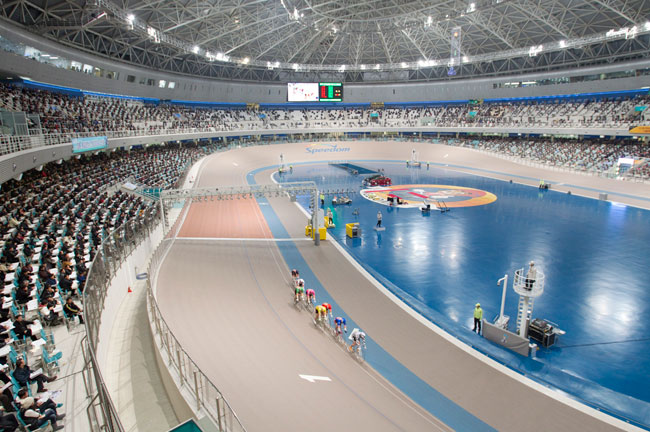 Largest-capacity velodrome, 30,000 capacity. Built in 2006, the velodrome was designed to resemble a cycling helmet, and is the largest domed structure in South Korea. It seats 9,574, and with standin