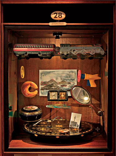 "A cabinet illustrates chapter 28, ""The Consolation of Objects."""