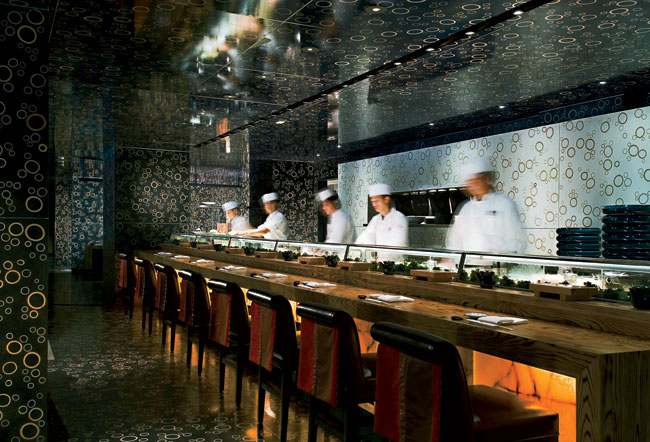 The Rockwell Group brings a similar brand of theatricality to its restaurants, including Nobu Fifty Seven (left, 2005), where it pairs with design-driven platings.