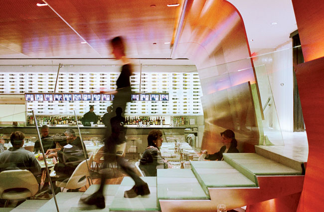 Diller + Scofidio also created some drama in 2000 with its voyeuristic entrance to the Brasserie in New York, where patrons at the bar watch new arrivals descend a flight of stairs on a row of video s