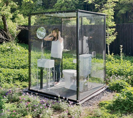 The architect's transparent stall (for women primarily) is surrounded by a 7-foot-high oval of wood fencing. The fence allows the stall's users to experience the scenic view while main