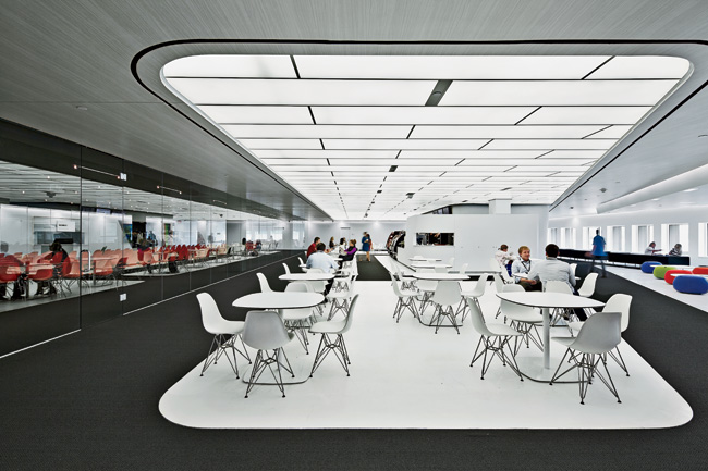 Hitoshi Abe drew employees to Building 225, at the northern end of the complex, by creating a futuristic café with a lounge on the side facing the plaza  and an assembly room called the Forum o