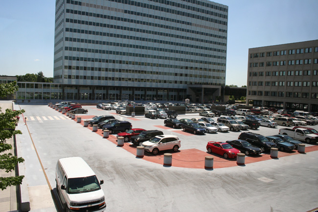 View of visitors parking lot and Building 220 before renovation project.