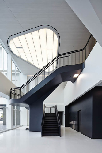 Hitoshi Abe created a two-story space for a new stair leading from the first floor of Building 224 to the lounge area near the new employee entrance.