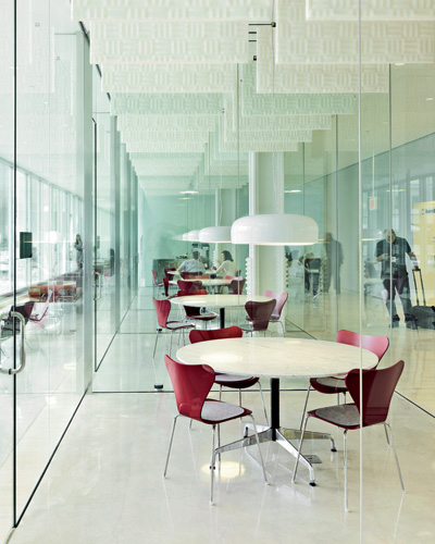 On the first floor of Building 220, Ebner created a series of glass cubes that serve as impromptu meeting rooms, adjacent to a long space that faces the plaza and provides a variety of furniture for i