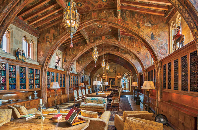 Hearst wanted his own office and library, so Morgan designed the Gothic Study (1931) on the main house's third floor. The ceiling combines 15th-century Spanish beams with arches designed in the Gothic