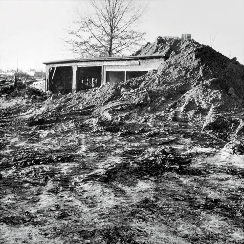 Robert Smithson created P<em>artially Buried Woodshed</em>, 1970 by piling earth onto a shed on the grounds of Kent State University in Ohio until its structure gave way.