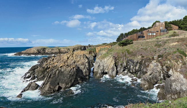 Condominium One, in all its rustic majesty, presides over an outcropping above the Pacific.