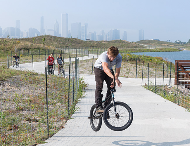 A mile-long path winds around the park for bikers, bird watchers, and other explorers to experience the island's serene stretches of lakefront.