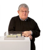 Stanley Tigerman shows his model for the Pacific Garden Mission, Chicago's oldest rescue center for the homeless, in 2006, a year before it opened.