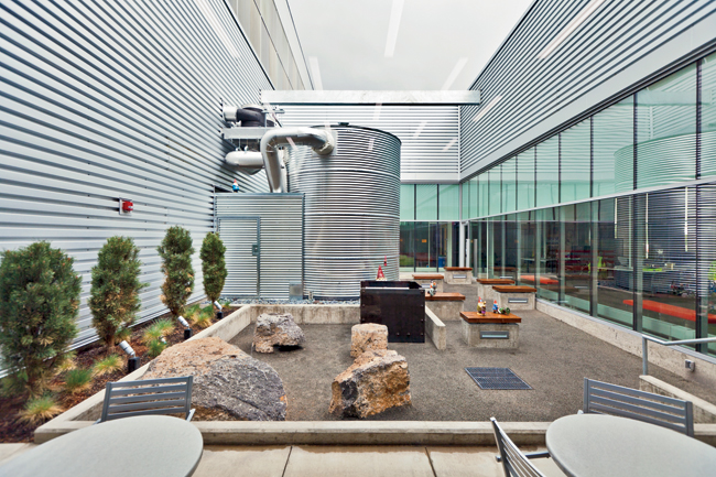 Where courtyards open into the office areas of the building, the concrete wall is replaced with full-height glazing, layered from the entry court deep into the office and the interior courtyard.