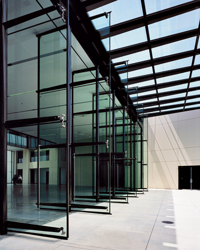 Pivoting glass doors connect the Design Center with the entry plaza.