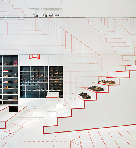 The concept for designer Jurgen Bey's shop in Lyon, which opened in 2011, is grounded in basic walking movements, as indicated by graphic red-on-white patterning on the ceiling, floors, and wall