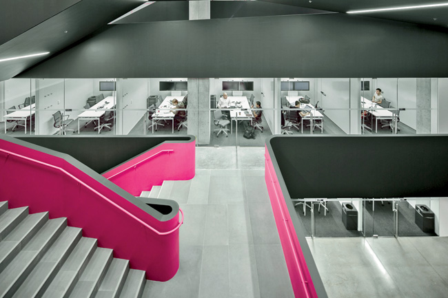 The first four levels are organized around a central atrium which features a pink-accented serpentine stair as a symbol of Rotman's commitment to creative thinking.