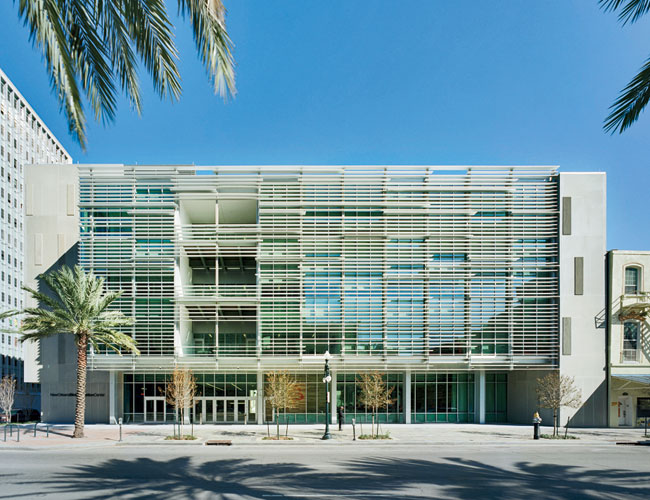 Playfully deployed louvers allow the main, southwest-facing facade to be 63 percent glass yet have the summer solar gain of a facade with only 20 percent glass.