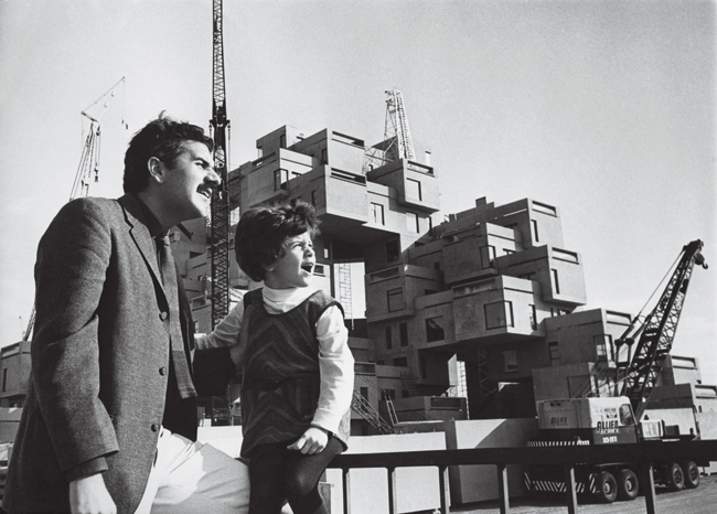 Moshe Safdie and his daughter Taal observe the construction of Moshe's Habitat 67 in Montreal. Taal, now an architect, lived in the apartment complex.