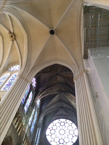 The newly cleaned and repainted columns and vaults contrasts sharply with the former ones in transept. The jewel-like, stained-glass, southern rose window in the background will lose the drama of emer