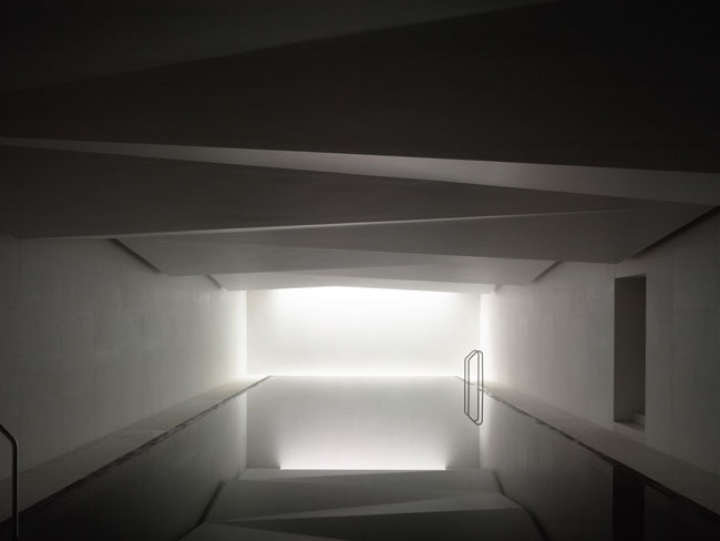 Tucked below an existing mansion in Limerick, Ireland, this private spa turns an underground facility into a poetic essay on space, light, and reflection. As part of the renovation of the former Bisho