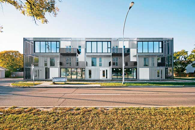 The firm designed 10 expansive condominiums for a young Winnipeg developer who wanted a project with a loftlike feel. Each apartment consists of three open-plan spaces set on separate levels. The firm