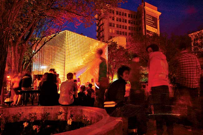 Located in Winnipeg's Old Market Square, the OMS Stage is an open-air performance space in a public plaza designed by landscape firm Scatliff+Miller+Murray. In the city's frequently freezing climate,