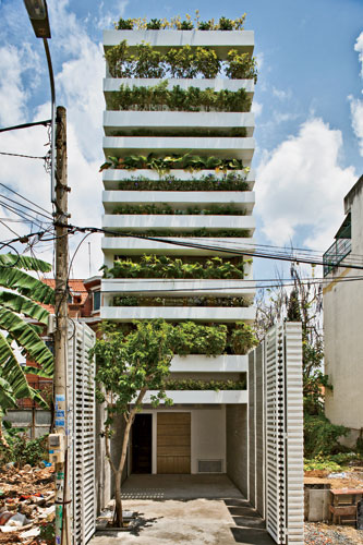 While their city is becoming increasingly dense and polluted, residents of Ho Chi Minh City still love their plants and trees. So Vo designed this 13-foot-wide private house with cantilevered planters
