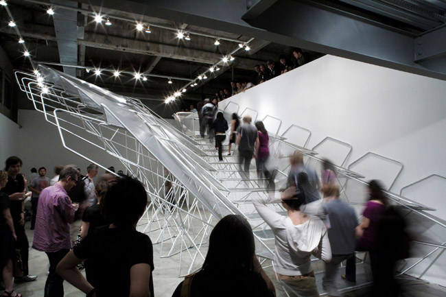 Call it the unstaircase—a not-to-code structure that lets people ascend from the ground level of SCI-Arc's gallery in L.A. to a catwalk above. The skeletal form, designed with Buro Happold