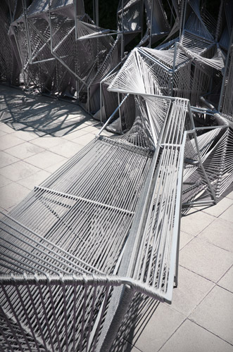 This 21-foot-long installation in Los Angeles, made of rope strung across steel framing, forms an optical illusion. Look at it straight on and you see a repeating, legible pattern. But move around it