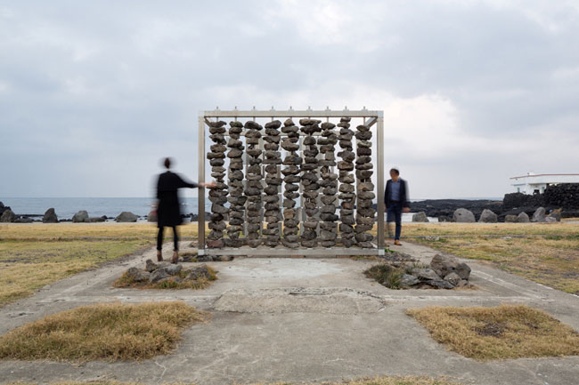 For a permanent installation on Jeju Island off the south tip of Korea, the architects collaborated with scientists at the Korea Institute of Energy Research, building a pair of facing walls—one