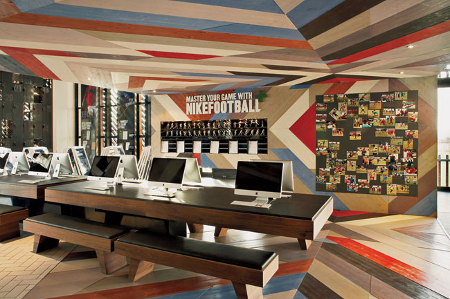 Interiors blend commercial images from Nike with social spaces for players.