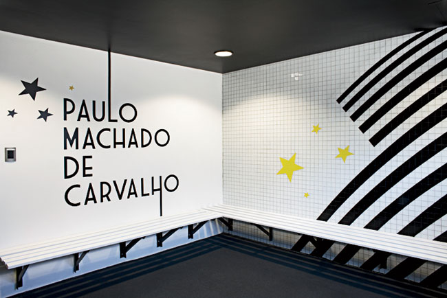 In a renovated structure behind the new building, RUFproject worked with the graphic design agency Grid Worldwide to stamp each dressing room with the logos and colors of famous football teams sponsor