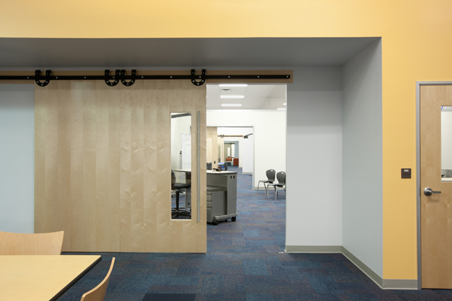 Sliding doors between classrooms are intended to facilitate collaboration among teachers.
