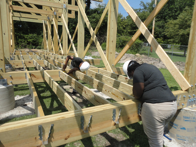 Students setting joists on the Windsor super market structure.
