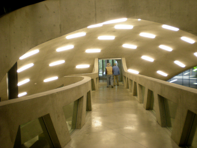 A walkway takes visitors under an interior dome to the building's auditorium.