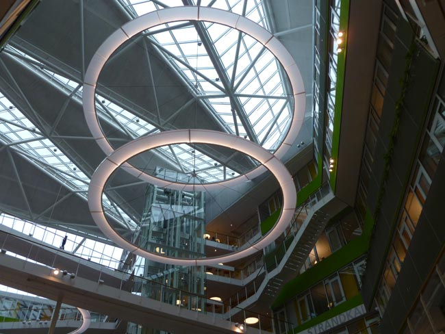 The atrium of Unilever Headquarters features large cirular LED rings. The building has received multiple awards, including Wold's Best Office Building at the 2009 World Architecture Awards.