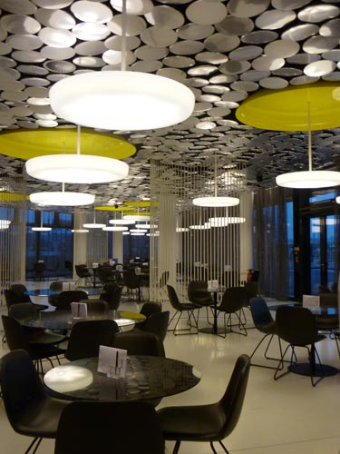 Stuttgart-based designers Peter Ippolito and Gunter Fleitz won the bid for the ground floor cafeteria, which features 4,300 aluminum discs on the ceiling.