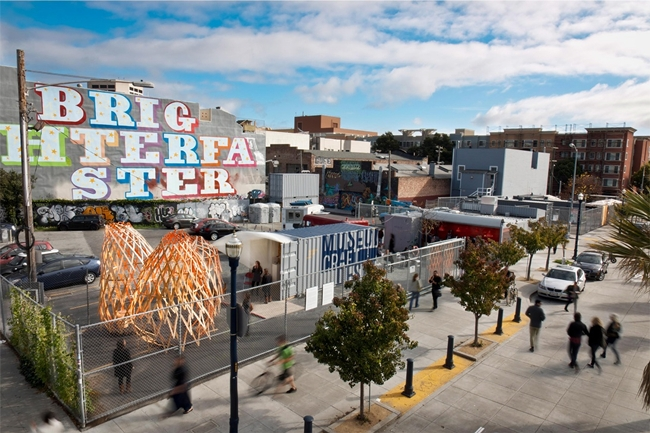 Leasing an empty site from the city, San Francisco firm Envelope a+d's <em>Proxy </em>redeveloped two large lots to become a kind of urban living room, with food stands, a temporary art gallery, a bee