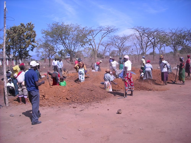 <p>In July 2009, Newman and his team from Engineers Without Borders NYC oversaw the design and construction of a small library for the community of Usalama in rural Kenya. &#160;Here, the community wo
