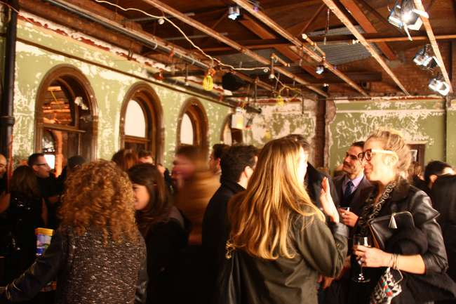 Event guests in a former office space at 5 Beekman Street.