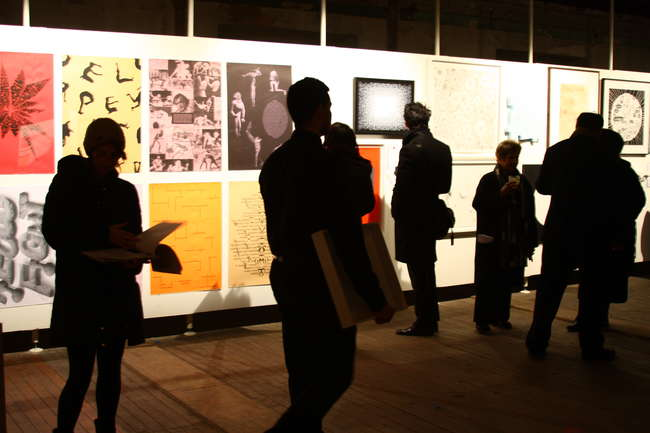 Event guests browse work in the benefit's silent auction.