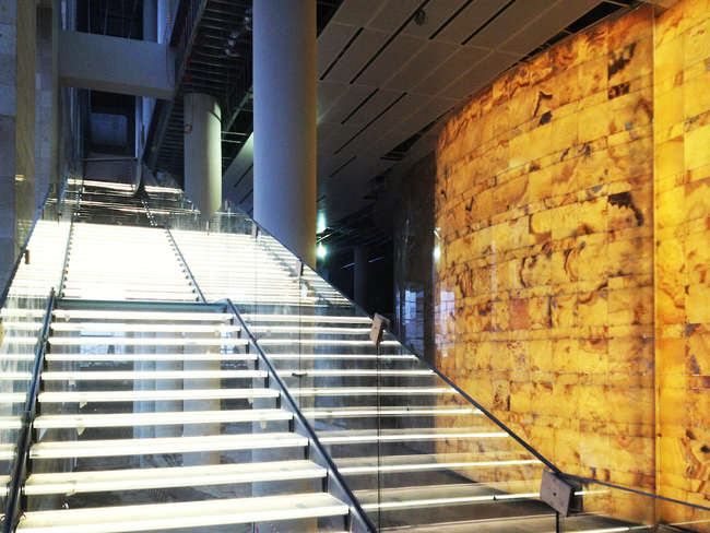 The Mariinsky II glass stair and backlit onyx wall in the lobby during construction.
