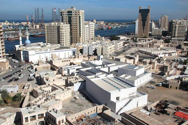 The 11th Sharjah Biennial sprawls through more than a dozen venues in and around the emirate's Heritage Area on the eastern bank of Sharjah Creek. (The Persian Gulf is visible in the background.