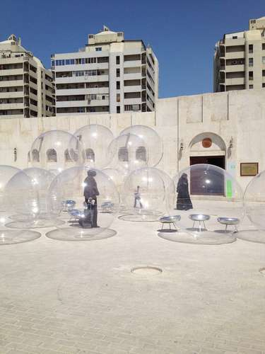 Kazuyo Sejima and Ryue Nishizawa of SANAA designed <em>Bubble</em>, 2013, literally a series of Plexiglass spheres, for a square near Sharjah&#8217;s calligraphy museum.