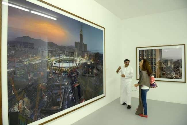 On the ground floor, photographs and an installation by Saudi artist Ahmed Mater critique the excesses on overdevelopment around the Masjid al-Haram in Mecca. Shown in monumental prints with an overpo