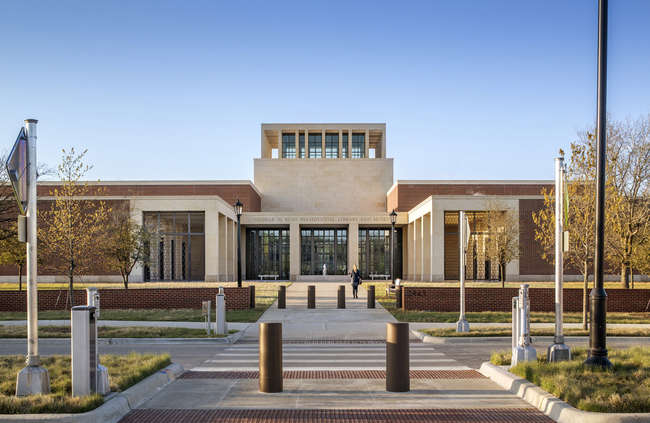 The George W. Bush Presidential Center by Robert A. M. Stern Architects is located on the campus of Southern Methodist University (SMU) in Dallas. Visitors enter through the limestone portico.